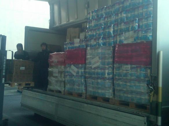 AmeriCares loading convoy aid shipment in Sendai